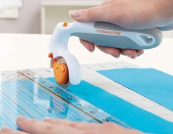 Fiskars foldable scissors and pivoting rotary cutter